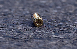 April 26, 2018 - Chicago, IL, USA - A shell casing remains on the scene on Oak Street near Rush Street in Chicago as police responded to a series of carjackings and shootings in the Gold Coast on Thursday, April 26, 2018. (Credit Image: © Terrence Antonio James/TNS via ZUMA Wire)