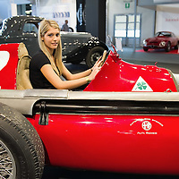 PADOVA, ITALY - OCTOBER 27:  An employee of Alfa Romeo sits at the wheel of a traditional vintage car on October 27, 2011 in Padova, Italy. The Vintage and Classic Cars Exhibition of Padova, running from the October 28 - 30, is the most important European trade show for vintage cars and motorbikes, showcasing over 1600 vehicles.