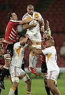 JOHANNESBURG, SOUTH AFRICA - 23 April 2011: Liam Messam of the Chiefs secures the ball despite the efforts of David de Villiers during the Super Rugby Match between the MTN Lions and the Chiefs held at Coca Cola Park Stadium, Johannesburg, South Africa. Photo by Dominic Barnardt
