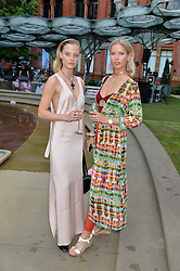 Left to right, EMILY STEEL and ANYA BARKER at the V&A Summer Party in association with Harrod's held at The V&A Museum, London on 22nd June 2016.