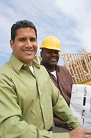 Architect and construction worker on construction site