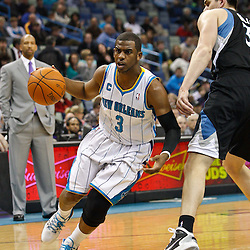 February 7, 2011; New Orleans, LA, USA; New Orleans Hornets point guard Chris Paul (3) drives past Minnesota Timberwolves center Darko Milicic (31) during the first quarter at the New Orleans Arena.   Mandatory Credit: Derick E. Hingle