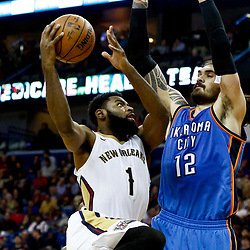 Jan 25, 2017; New Orleans, LA, USA; New Orleans Pelicans guard Tyreke Evans (1) shoots over Oklahoma City Thunder center Steven Adams (12) during the second half of a game at the Smoothie King Center. The Thunder defeated the Pelicans 114-105. Mandatory Credit: Derick E. Hingle-USA TODAY Sports