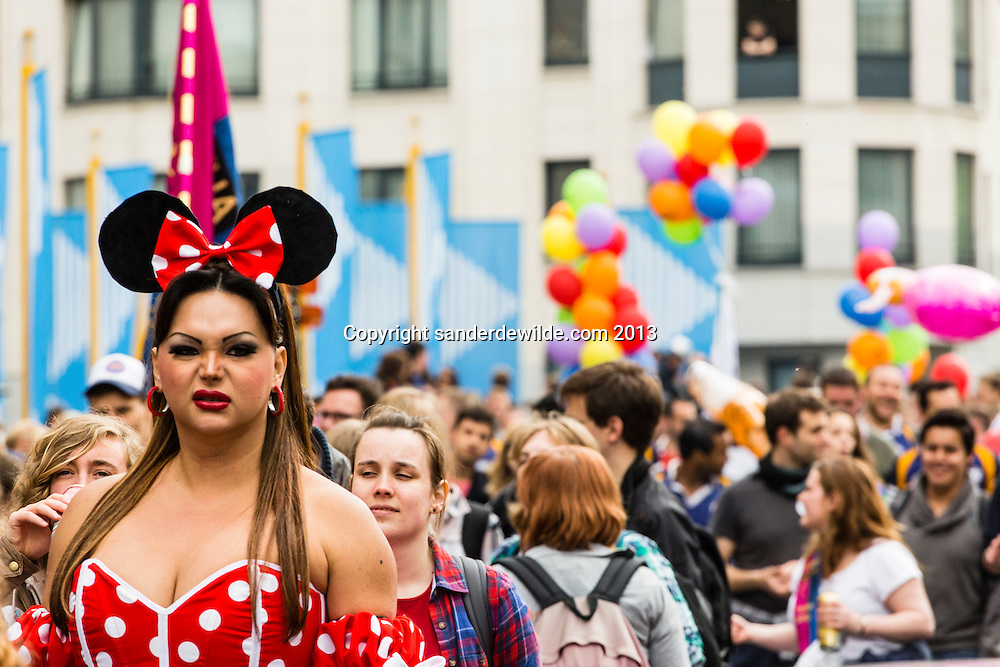 Belgium, Brussels, 19 May 2013. All sorts of gay people dressed up in the parade, with disney mouse in front. About 80,000 participants at the Belgian Pride Parade to celebrate the LGBT (Lesbian, gay, bisexual, transgender) community and demand equal rights..Belgium celebrates its 10th anniversary of gay marriage and seven years of the opening of adoption in same-sex couple.