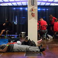 Greggory Hussey relaxes and listens to music backstage before the start of the MMA fight on Saturday, August 5th during the Summit Fighting Championships match at the Tupelo Furniture Market. Hussey was fighting in one of the title fights of the night.