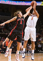 Virginia forward Lyndra Littles (1) is fouled by Georgia guard Ashley Houts (1) while shooing a jump shot.  The #15 ranked Virginia Cavaliers defeated the Georgia Lady Bulldogs 62-60 in NCAA Women's Basketball at the John Paul Jones Arena on the Grounds of the University of Virginia in Charlottesville, VA on January 2, 2009.