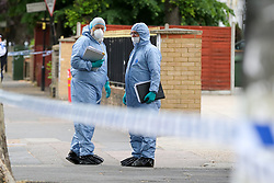 © Licensed to London News Pictures. 28/05/2019. London, UK. London, UK. Forensic officers on Romford Road, Forest Gate, East London where a man in his 30s died in the early hours of this morning following a flight on Warwick Road.<br />