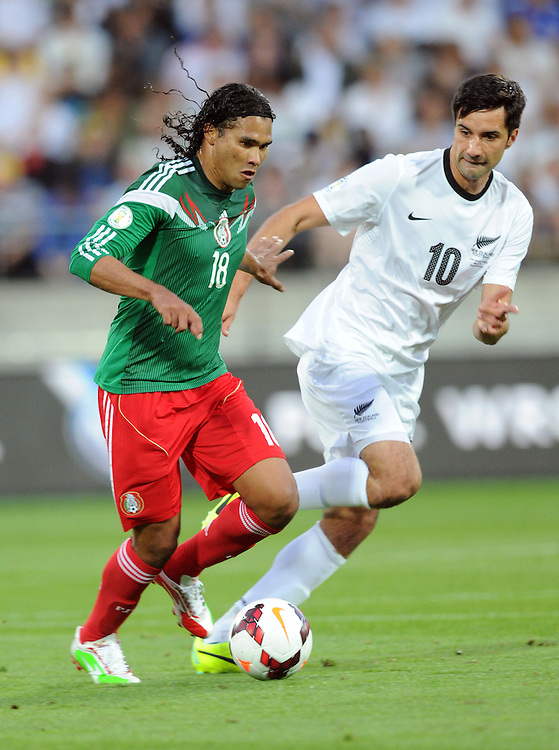 Mexico's Carlos Pena, left against New Zealand's Rory Fallon in the World Cup Football qualifier, Westpac Stadium, Wellington, New Zealand, Wednesday, November 20, 2013. Credit:SNPA / Ross Setford