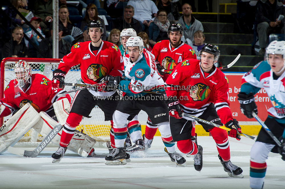 KELOWNA, CANADA - APRIL 7: Erik Gardiner #12 of the Kelowna Rockets checks Conor MacEachern #4 of the Portland Winterhawks in front of the net during first period on April 7, 2017 at Prospera Place in Kelowna, British Columbia, Canada.  (Photo by Marissa Baecker/Shoot the Breeze)  *** Local Caption ***