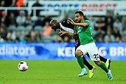 Martin Montoya (#22) of Brighton & Hove Albion and Jetro Willems (#15) of Newcastle United battle for possession of the ball during the Premier League match between Newcastle United and Brighton and Hove Albion at St. James's Park, Newcastle, England on 21 September 2019.