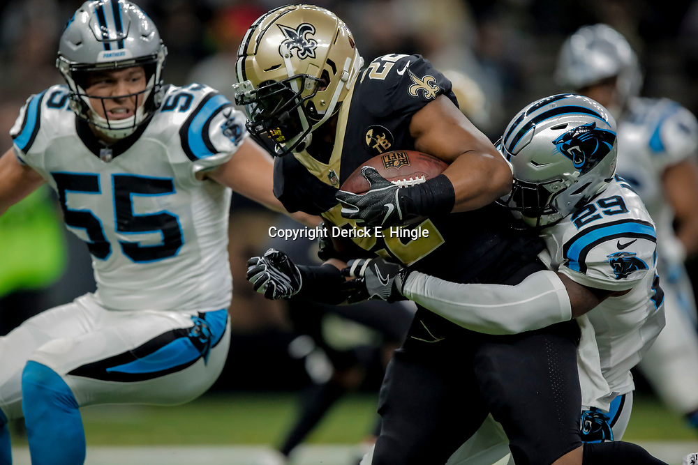 Dec 30, 2018; New Orleans, LA, USA; New Orleans Saints running back Mark Ingram II (22) is tackled by Carolina Panthers safety Mike Adams (29) during the second quarter at the Mercedes-Benz Superdome. Mandatory Credit: Derick E. Hingle-USA TODAY Sports