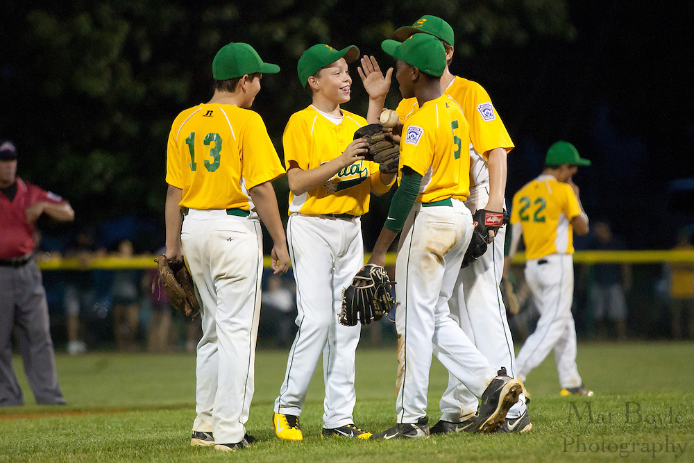 The Erial infield talks to Adam Holland during a Section 4 Little League final against Cherry Hill held in Gloucester Sunday night.