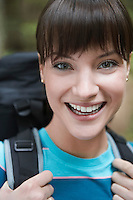 Woman wearing backpack close-up portrait