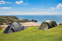 Tents at campsite overlooking beach<br /> Three Cliffs Bay Holiday Park<br /> Gower Peninsula<br /> County of Swansea<br /> South<br /> Camping and Caravanning<br /> Accommodation