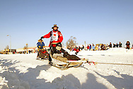 3/3/2007:  Anchorage Alaska -  Veteran Aliy Zirkle of Two Rivers, AK powers into the first corner of the 35th Iditarod Sled Dog Race
