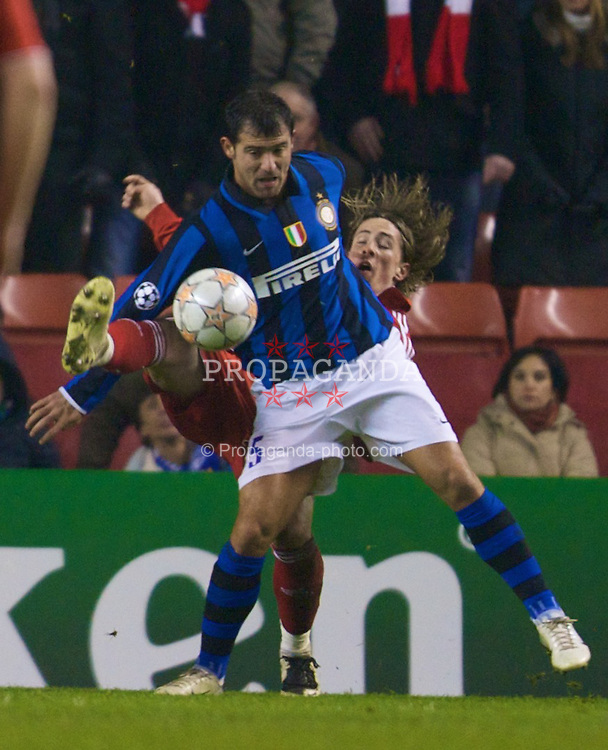 LIVERPOOL, ENGLAND - Tuesday, February 19, 2008: Liverpool's Fernando Torres and FC Internazionale Milano's Dejan Stankovic during the UEFA Champions League First Knockout Round 1st Leg match at Anfield. (Photo by David Rawcliffe/Propaganda)