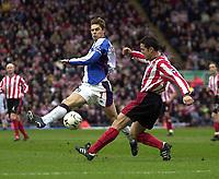 Photo. Glyn Thomas<br />Blackburn Rovers v Southampton. FA Barclaycard Premiership.<br />Ewood Park, Blackburn. 08-02-2003.<br />Blackburn's Garry Flitcroft (L) aims for goal past Paul Telfer