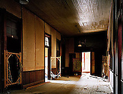 When the red light goes out: Stunning photographs capture eeriness of world's abandoned brothels<br /> <br /> The doors to the world's oldest and most secretive profession are closely guarded - to all but the paying customer that is - making them the subject of much intrigue and mystery. <br /> A series of photographs, capturing abandoned brothels around the world, gives a rare glimpse into the seedy underworld of prostitution and the patrons it caters for. <br /> The typical, tasteless decor of red velvet and garish paint are now streaked with dust, the mirrored walls are smudged and grimy while novelty beds lie covered in debris.<br /> The images capture the tawdry appearance of brothels along with the air of desperation and loneliness which permeates the deserted rooms long after the last women have left. <br /> There is little given away about the people who lived, worked and visited the brothels, such is the murky world of prostitution - despite their existence as far back as records began. The earliest mention of brothels appeared in records of the Sumerians in 4000 BC - operated by priests and dedicated to the goddess Ishtar.<br /> <br /> The roots of the word brothel can be traced back to the old English word breothan which means 'to decay' or 'to go to ruin'.<br /> The unsavoury destinations are worldwide but some stand out from the seedy crowd. In Carson City, just northwest of 'Sin City' Las Vegas, is the legendary Moonlite Bunny Ranch. It is owned by Dennis Hof, the self-styled 'Pimpmaster General', and his club has the dubious honour of being endorsed by sex addicts like Howard Stern, Larry Flynt and Hugh Hefner.<br /> Across the pond, at Big Sister in Prague, the services are free - but there is a catch. On completion of your private moment, the club then beams it around the world via cable TV - and a similar venue is due to open in the U.S. soon. <br /> ©abandonalia.blogspot.com/Exclusivepix