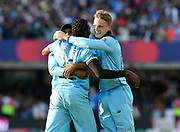 England Are World Champions - Adil Rashid of England, Jofra Archer of England and Jos Buttler of England celebrate after Martin Guptill of New Zealand is run out in the super over and England win the World Cup during the ICC Cricket World Cup 2019 Final match between New Zealand and England at Lord's Cricket Ground, St John's Wood, United Kingdom on 14 July 2019.