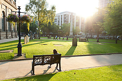 © Licensed to London News Pictures. 13/09/2016. Birmingham, West Midlands,  UK. Early morning sunlight shines on St. Phillips Cathedral Park. The day starts with clear skies and warm temperatures in Birmingham, West Midlands, UK. Temperatures of mid twenties deg centigrade are forecast today for Birmingham. Photo credit: Graham M. Lawrence/LNP