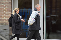 © Licensed to London News Pictures. 06/01/2019. London UK: Police officers carrying evidence bags at Baltimore Wharf in Eastferry road on the Isle of Dogs where a female in her 30's was found with fatal stab wounds on Saturday evening. A male aged 32 has was arrested at the scene and is being questioned by police, Photo credit: Steve Poston/LNP