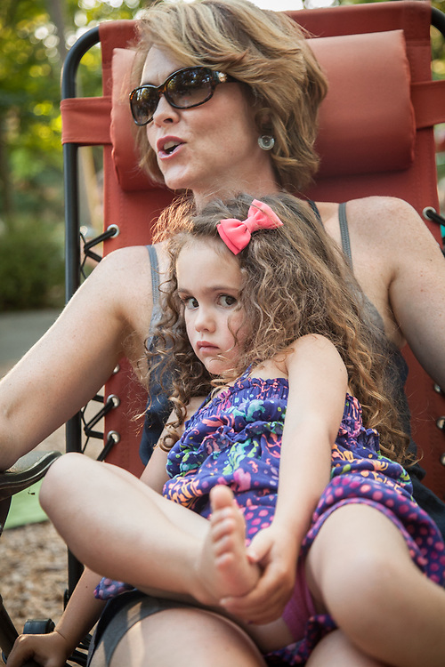 Jenett Miller with her three year old daughter, Adalyn, at a Concert in Pioneer Park, Calistoga