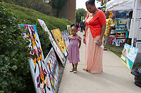 """The Harambee Art and Craft Music Festival celebrated its seventh year in Chicago Sunday morning as participants were treated to arts, crafts and performances from all over the world. The event was held on 53rd Street in front of Nichols Park located at 1355 E. 53rd Street.<br /> <br /> 8820 – Kalea Polk and her daughter Kennedy Polk-Rice enjoy some of the different art pieces.<br /> <br /> Please 'Like' """"Spencer Bibbs Photography"""" on Facebook.<br /> <br /> Please leave a review for Spencer Bibbs Photography on Yelp.<br /> <br /> All rights to this photo are owned by Spencer Bibbs of Spencer Bibbs Photography and may only be used in any way shape or form, whole or in part with written permission by the owner of the photo, Spencer Bibbs.<br /> <br /> For all of your photography needs, please contact Spencer Bibbs at 773-895-4744. I can also be reached in the following ways:<br /> <br /> Website – www.spbdigitalconcepts.photoshelter.com<br /> <br /> Text - Text """"Spencer Bibbs"""" to 72727<br /> <br /> Email – spencerbibbsphotography@yahoo.com"""