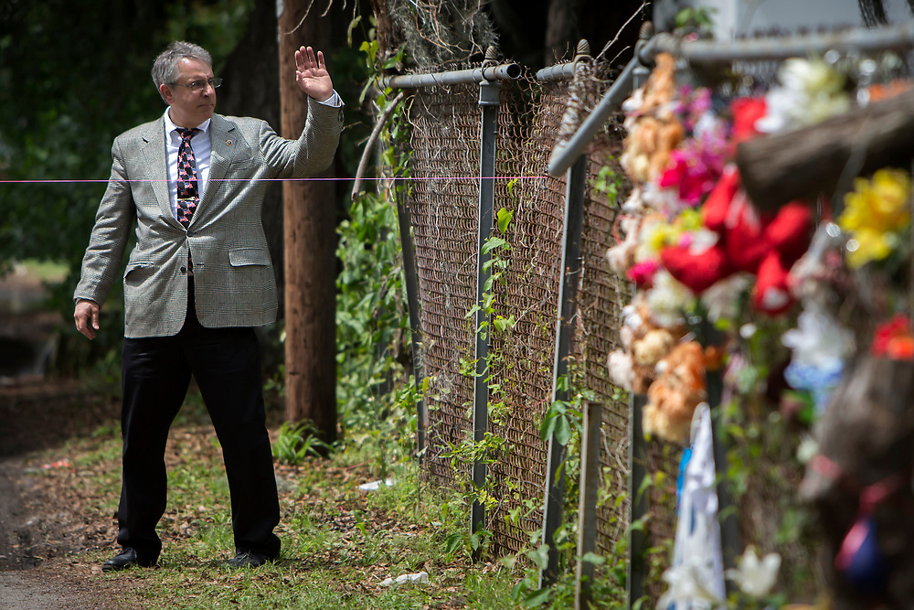 NORTH CHARLESTON, SC. - APRIL, 20, 2015: Law enforcement detectives and forensic experts walk near the site where Walter Scott was shot to death by a white North Charleston police officer in North Charleston, S.C.<br /> <br /> CREDIT: Stephen B. Morton for The New York Times