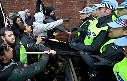 © under license to London News Pictures. 11/11/2010. Police hold back Muslims Against Crusaders demonstrators at their demonstration in Kensington, London, on Armistice Day.