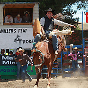 Craig Robson from Oamaru in action during the Open Bareback competition at the Millers Flat Rodeo. Otago, New Zealand. 26th December 2011