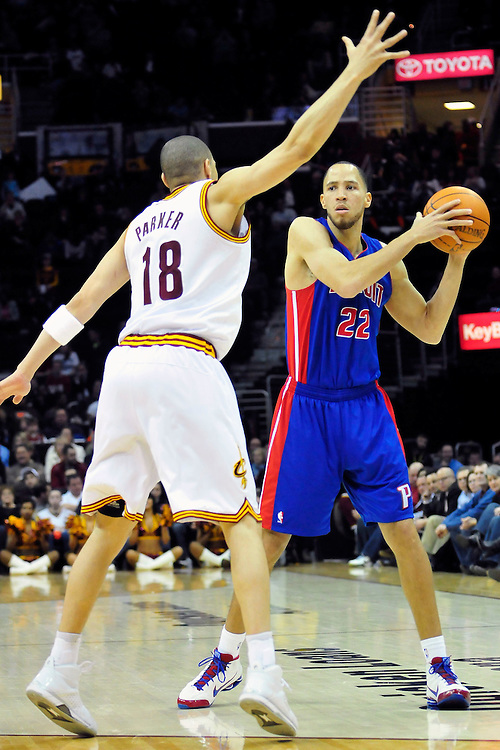 Feb. 9, 2011; Cleveland, OH, USA; Detroit Pistons small forward Tayshaun Prince (22) looks for a pass around Cleveland Cavaliers shooting guard Anthony Parker (18) during the fourth quarter at Quicken Loans Arena. The Pistons beat the Cavaliers 103-94 for Cleveland's 26th loss in a row. Mandatory Credit: Jason Miller-US PRESSWIRE