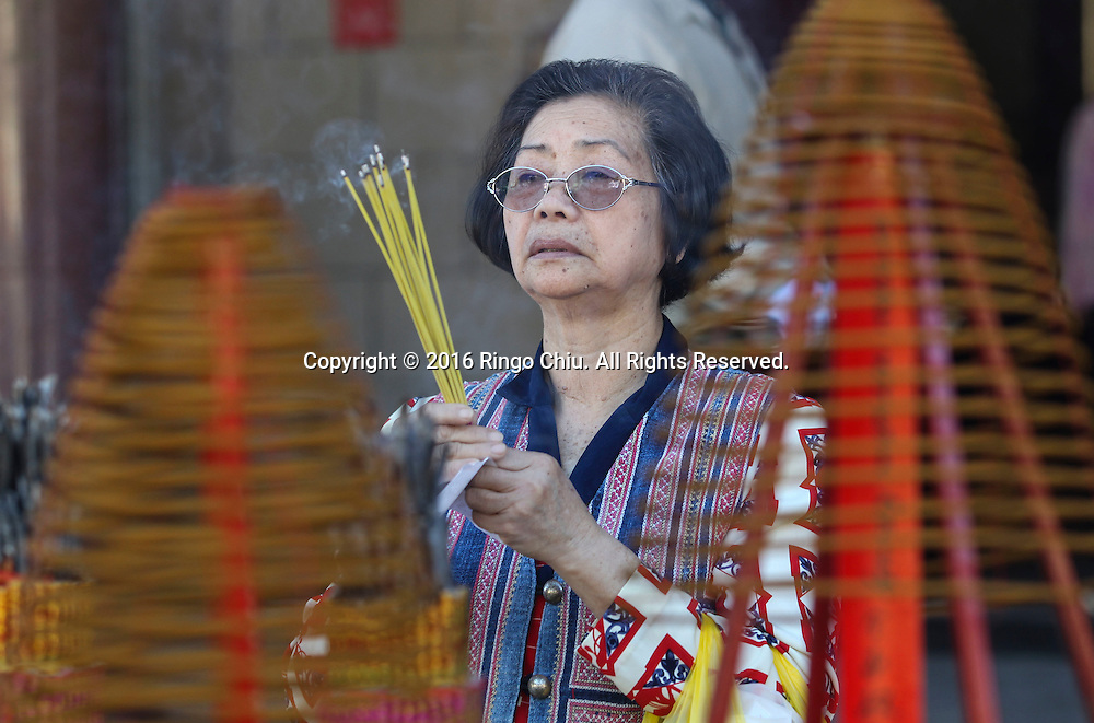 A woman prays at the Thien Hau temple to celebrate the first day of the Chinese Lunar New Year, the Year of the Monkey, on Monday February 8, 2016, in Los Angeles.(Photo by Ringo Chiu/PHOTOFORMULA.com)<br /> <br /> Usage Notes: This content is intended for editorial use only. For other uses, additional clearances may be required.