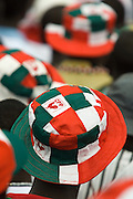 Convention People's Party (CPP) supporters wear hats in the colors of their party during a rally in Accra, Ghana on Sunday September 21, 2008.