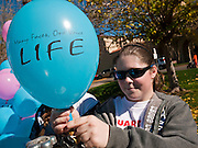 23 JANUARY 2011 - PHOENIX, AZ: MARY PETERSEN, from Phoenix, inflates helium balloons with a pro-life message before the March for Life through Phoenix, AZ, Sunday. About 500 people participated in the pro-life march and rally, which marked the 38th anniversary of the US Supreme Court's Roe vs. Wade decision, which legalized abortion in the United States.   PHOTO BY JACK KURTZ