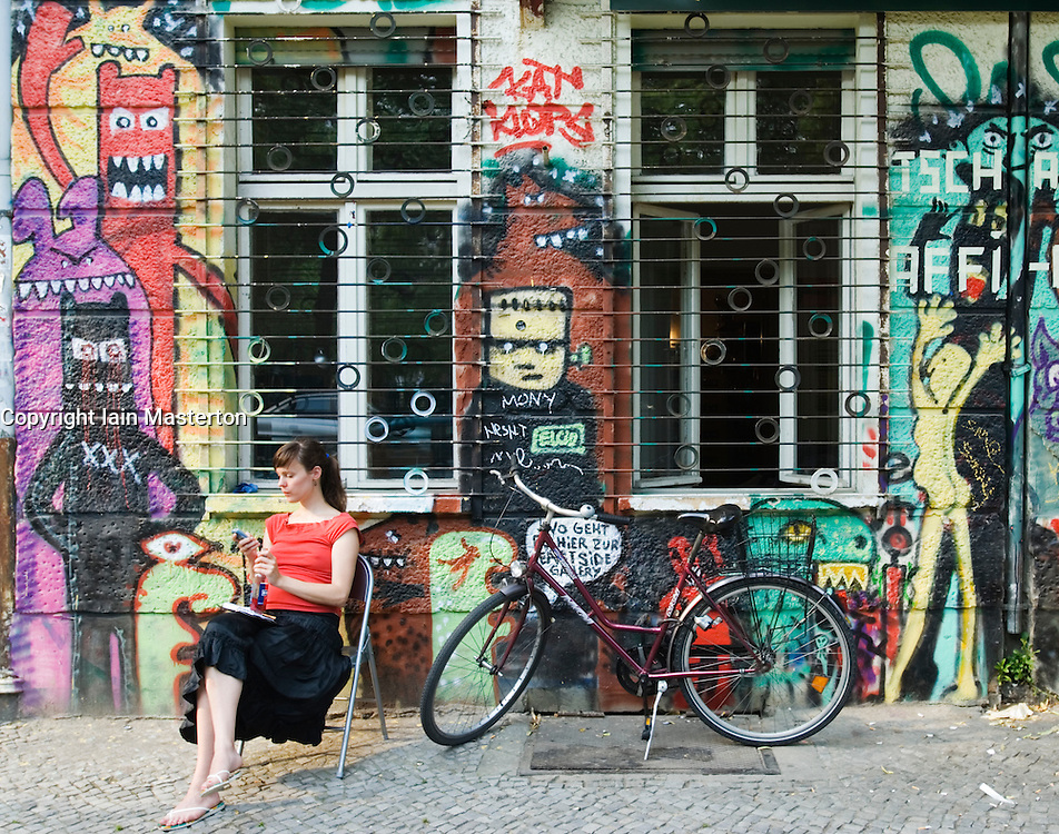 Graffiti covered apartment building in bohemian district of Friedrichshain in Berlin