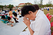 "Sept. 26, 2009 -- PATTANI, THAILAND:  Buddhist women in Pattani, Thailand, pray during the Tak Bat Sankatan ceremony Saturday. Buddhists in Thailand's three southern most provinces gathered in Pattani Saturday, Sept 26 to celebrate Tak Bat Sankatan, the day Lord Buddha returned to earth and was greeted by a crawd of his disciples and Buddhist believers who were waiting to offer him food. Buddhists monks representing the 266 ""Wats"" (temples) in the three provinces (Pattani, Narathiwat and Yala) processed through the crowd and were presented with food and gifts.   Photo by Jack Kurtz"