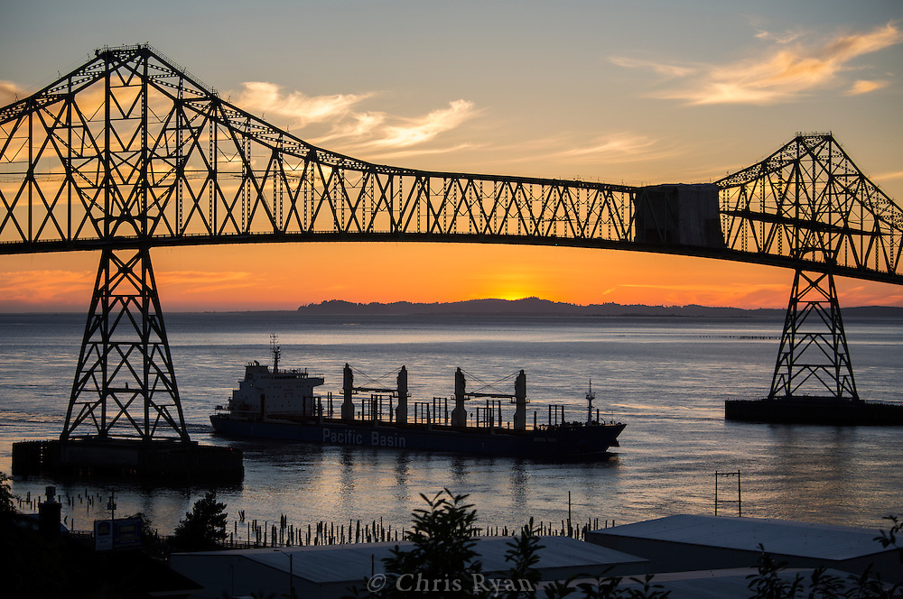 Cargo ship at sunset under the Astoria-Megler bridge, Columbia River, Astoria, Oregon