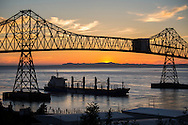Cargo ship at sunset under the Astoria-Megler bridge, Columbia River, Astoria, Oregon