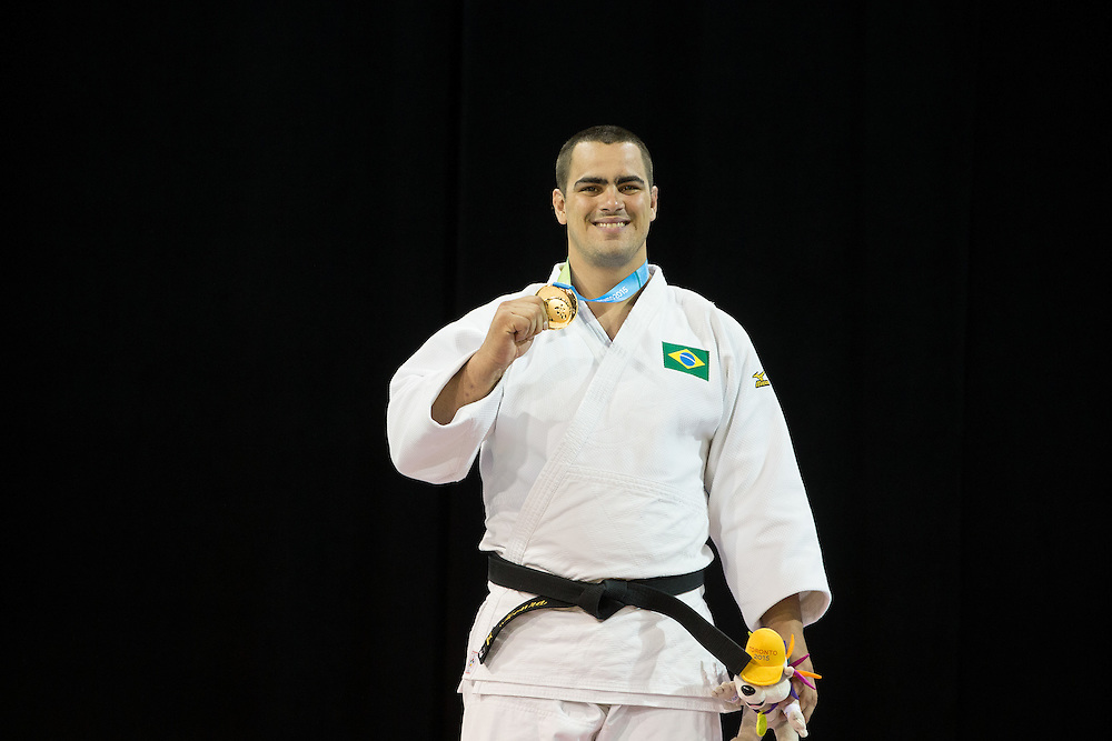 David Moura of Brazil smiles for photographs after receiving his gold medal in the men's judo +100kg class at the 2015 Pan American Games in Toronto, Canada, July 14,  2015.  AFP PHOTO/GEOFF ROBINS