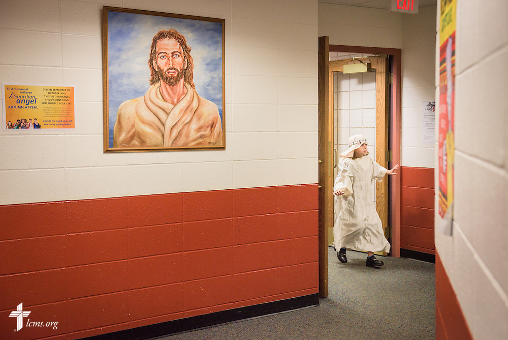 A young student dressed for a theatrical production walks through the hallway on Friday, Oct. 28, 2016, at First Immanuel Lutheran School in Cedarburg, Wis. LCMS Communications/Erik M. Lunsford