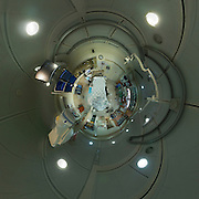 Polar panorama of a hospital X-ray machine and room.