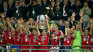 (C) Philipp Lahm of Monachium with the European Cup after winning the UEFA Champions League Final football match between Borussia Dortmund and Bayern Munich at Wembley Stadium in London on May 25, 2013...England, London, May 25, 2013..Picture also available in RAW (NEF) or TIFF format on special request...For editorial use only. Any commercial or promotional use requires permission...Photo by © Adam Nurkiewicz / Mediasport
