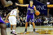 Oct. 30, 2010; Cleveland, OH, USA; Sacramento Kings point guard Beno Udrih (19) calls a play with under pressure from Cleveland Cavaliers point guard Ramon Sessions (3) during the third quarter against the \ at Quicken Loans Arena. The Kings beat the Cavaliers 107-104. Mandatory Credit: Jason Miller-US PRESSWIRE