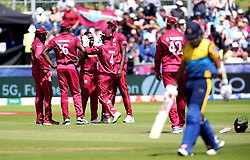 West Indies Fabian Allen celebrates with his team after taking the wicket of Sri Lanka's Kusal Mendis during the ICC Cricket World Cup group stage match at The Riverside Durham, Chester-le-Street.
