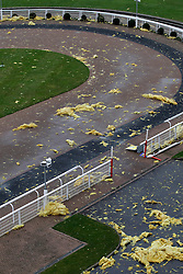 © Licensed to London News Pictures. 03/01/2012, London, UK. Roof insulation materials are scattered on the parade ring from the partly wind damaged grandstand roof of Epsom Down race course in south London as stormy weather hit part of UK, Tuesday, Jan. 3, 2012. Photo credit : Sang Tan/LNP