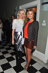Left to right, NOELLE RENO and HOLLY VALANCE at a champagne reception to launch The Big Egg Hunt presented by Faberge in aid of the charities Action for Children and Elephant Family held at 29 Portland Place, London on 18th January 2012.