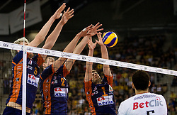 Oliver Venno, Alen Pajenk and Andrej Flajs of ACH vs Osmany Portuondo Juantorena of Trentino at 2nd Semifinal match of CEV Indesit Champions League FINAL FOUR tournament between ACH Volley, Bled, SLO and Trentino BetClic Volley, ITA, on May 1, 2010, at Arena Atlas, Lodz, Poland. Trentino defeated ACH 3-1. (Photo by Vid Ponikvar / Sportida)