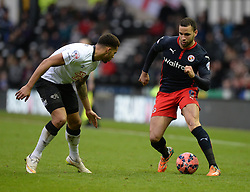 Reading's Hal Robson-Kanu attacks down the wing under pressure from Derby County's Cyrus Christie - Photo mandatory by-line: Alex James/JMP - Mobile: 07966 386802 - 14/02/2015 - SPORT - Football - Derby  - ipro stadium - Derby County v Reading - FA Cup - Fifth Round
