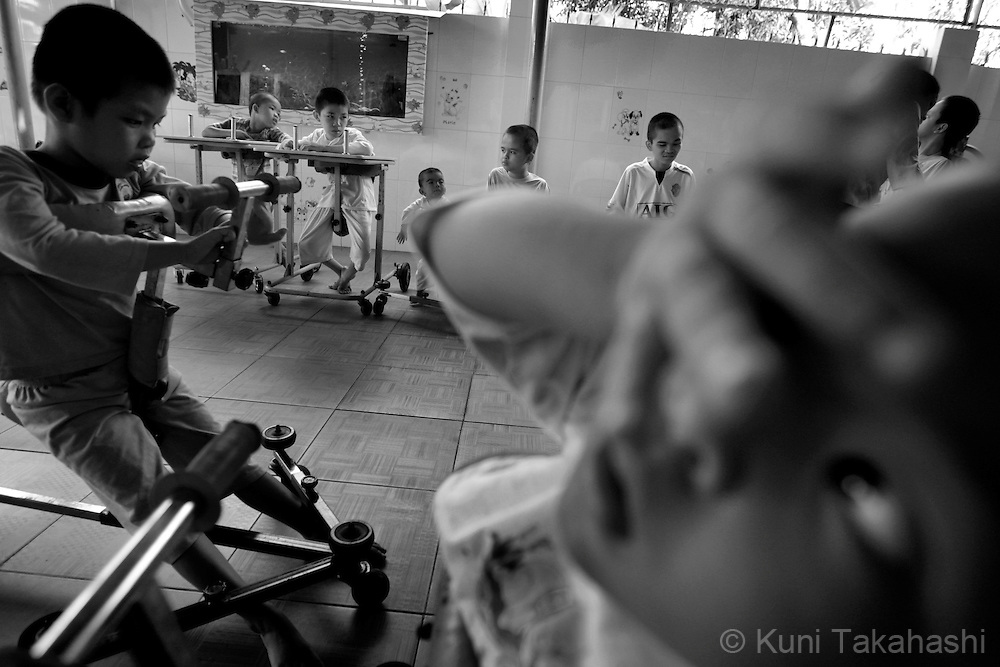 Children suffering from mental and physical disabilities are seen in Thien Phuoc Center for Handicapped Children in Ho Chi Minh City, Vietnam on July 7, 2009..Many children in the center who are from areas that were heavily sprayed by Agent Orange during the war, suffer mental and physical problems due to exposure to the toxic herbicide..