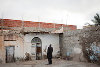 Kairouan, Tunisia - 18 December, 2011: Said Ferjani, 57, senior member of the political and communication bureau of the Nahda (Renaissance) party, looks at what remains of his father's house who died in 2006 in Kairouan, Tunisia on 18 December, 2011. Said Ferjan's father died in Kairouan 2006 while Said was in exile in the UK since 1989. Said Ferjani started his activism in the Negra mosque of his hometown Kairouan when he was 16 years old, debating on politics, philosophy, economy and world events. In 1989 former dictator Zine El Abidine Ben Ali turned against Nahda (or Ennahda) and jailed 25,000 activists. Said Ferjani was jailed and tortured. He then flew Tunisia and moved to the UK. He came back to Tunisia after 22 years, after former dictator Ben Ali flew the country.<br /> <br /> Gianni Cipriano for The New York Times